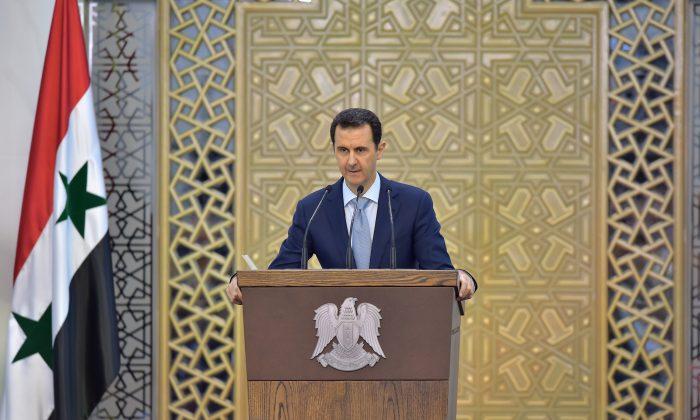 Syrian President Bashar al-Assad delivers a speech in Damascus, Syria, on July 26, 2015. (SANA via AP)