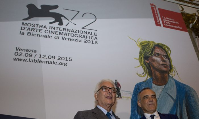 Venice Biennale President Paolo Baratta and Italian Festival Director Alberto Barbera, right, pose prior to a press conference to present the Venice Film Festival, in Rome Wednesday, July 29, 2015. (AP Photo/Alessandra Tarantino)