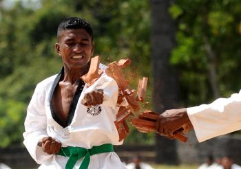 MARTIAL ARTS: Positioning the body and using the muscles correctly is crucial to using the body's energies well. (Ishara S. Kodikara/AFP/Getty Images)