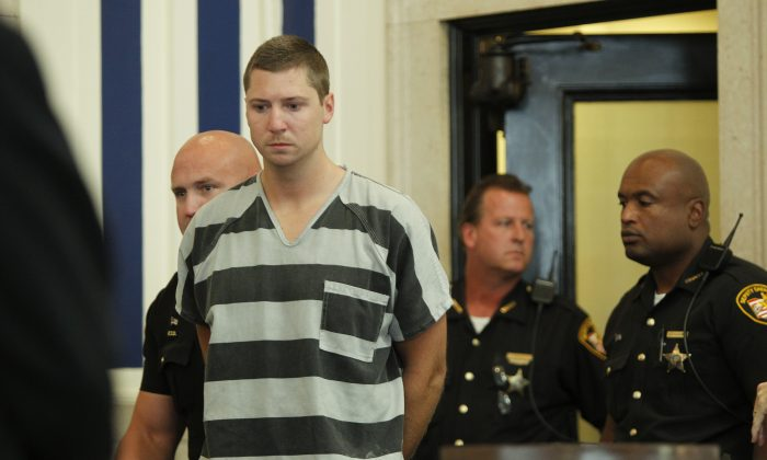 Former University of Cincinnati police officer Ray Tensing enters Hamilton County Common Pleas Court to be arraigned on murder charges July 30,  2014 in Cincinnati, Ohio. (Mark Lyons/Getty Images)