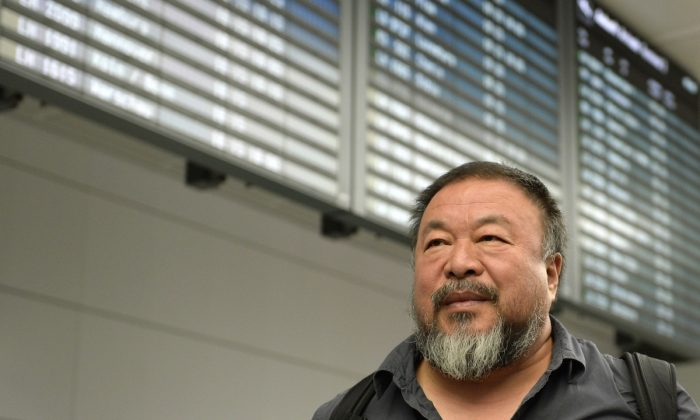Chinese artist Ai Weiwei gives an interview as he leaves the Franz-Josef-Strauss airport in Munich, southern Germany, after his arrival from China on July 30, 2015. (Christof (Stache/AFP/Getty Images)