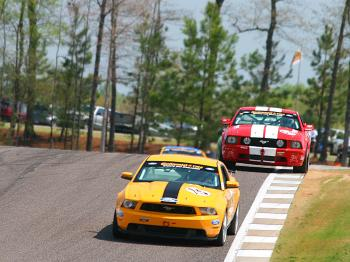The Roush and Multimatic Mustangs fight for the lead. (James Fish/The Epoch Times)