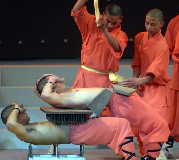 Shaolin monks demonstrate the strength they have cultivated through Chinese hard qigong. (Adek Berry/AFP/Getty Images)