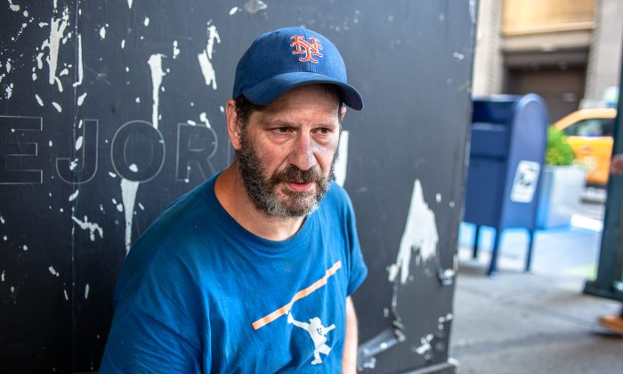 Darren Miller, 49, who has been homeless for six years, across the street from the Madison Square Garden in Chelsea, Manhattan, New York, on July 27, 2015. (Petr Svab/Epoch Times)