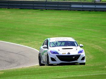 After the #27 Freedom Autosports Mazda Speed 3 fought for podium positions all day, driver eric Foss ended up stalled in the grass in the final laps. (James Fish/The Epoch Times)