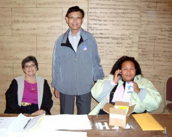 Judge of Election Sheila Robinson (right), staff Marlyn Kline (left) with Allan Wang (middle) at the polling place in Philadelphia's Benjamin Franklin House. Wang served as a translator assisting a group of 30 plus Chinese seniors with voting.  (Pamela Tsai/Epoch Times)