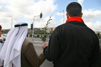 Arabs and Jews hold hands along a street.  (Tikva Mahabad/The Epoch Times)