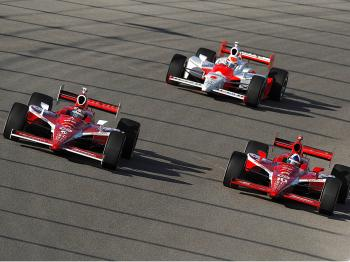 Scott Dixon in the #9 car leads his teammate Dario Franchitti in the #10 and Ryan Briscoe in the #6 in the opening laps of the IRL IndyCar Series Firestone Indy 300 at Homestead-Miami Speedway. (Robert Laberge/Getty Images)