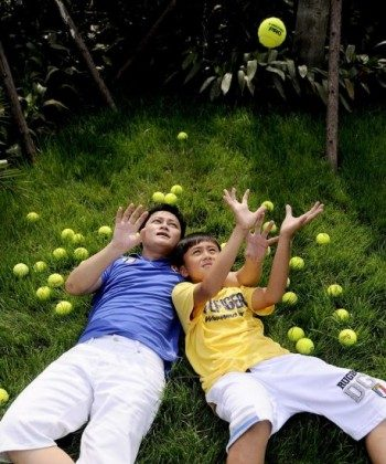 Li Chengpeng and his son in a sponsorship ad for the boy's tennis talent by a nonpolitical company promoting healthy interaction between parents and children. Authorities banned the image from being printed in newspapers. (Li Chengpeng's blog)
