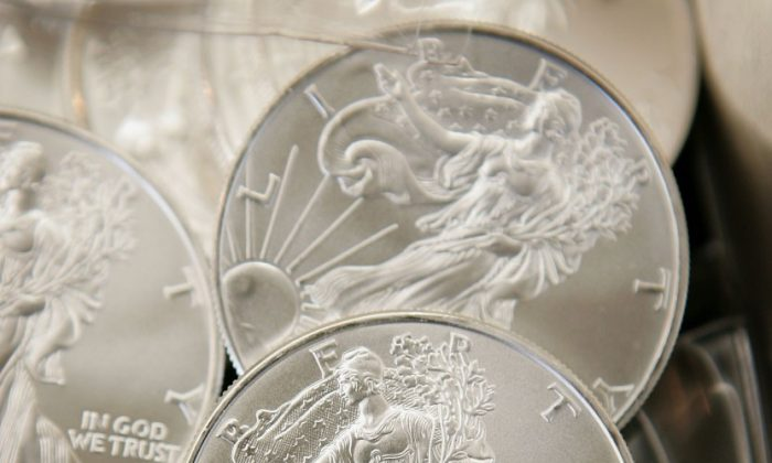 Silver bullion and coins are offered for sale at the Chicago Coin Company May 11, 2006, in Chicago, Ill. Researchers say that the available silver supply is limited, and there will be no in-ground silver available in about 25 to 30 years. (Scott Olson/Getty Images)