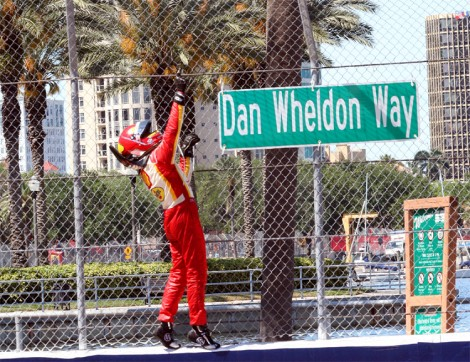 Helio Castroneves points heavenward, honoring his fallen friend and fellow driver Dan Wheldon. (James Fish/The Epoch Times)