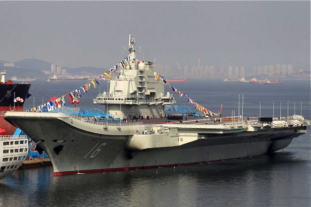 "China's first aircraft carrier, a former Soviet carrier called the ""Varyag,"" docked in Dalian, in northeast China's Liaoning Province, on Sept. 24, 2012.  The Chinese regime renamed the aircraft carrier ""Liaoning.""  (STR/AFP/Getty Images)"