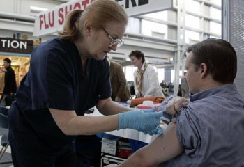 A Chicago man gets a flu shot from a nurse in the United Terminal in  2006 at O'Hare Airport in Chicago, Illinois. (Jeff Haynes/AFP/Getty Images)