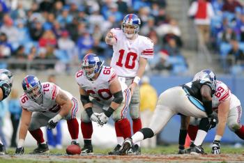 READY TO RUMBLE: Quarterback Eli Manning and the New York Giants will take on the Carolina Panthers this Sunday night for a chance to win home-field advantage throughout the NFC playoffs.  (Grant Halverson/Getty Images)