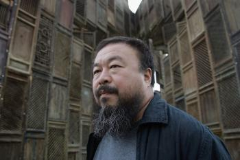 Chinese Artist Ai Weiwei poses in front of his sculpture 'Template'. (Simon/Getty Images)