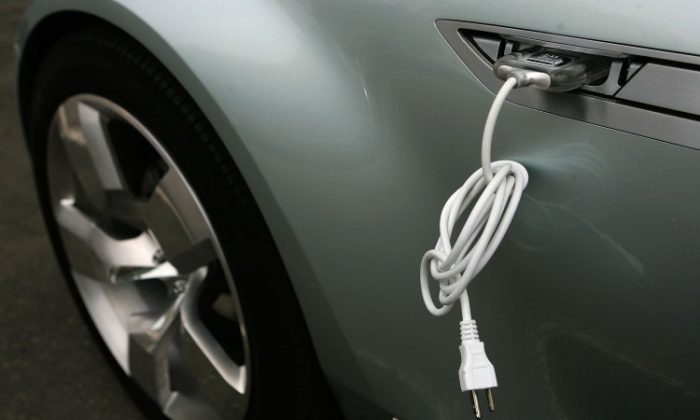An electric cable is attached to the side of a Chevrolet Volt vehicle during a viewing on Capitol Hill in this file photo. Most EV drivers spend about $30 on electricity with an averaging 1,050 miles per month, which is a growing alternative to rising gas prices. (Alex Wong/Getty Images)