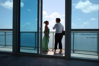 A real estate agent from Kamany Realty, (R) shows a women around a condo for sale in Miami, Florida.   (Joe Raedle/Getty Images)
