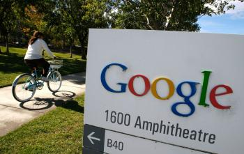 A Google employee rides a bicycle at the company's headquarters in Mountain View, California. (Justin Sullivan/Getty Images)