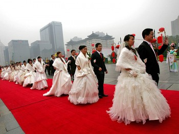 China's new marriage law amendment is controversial for favoring men and not protecting women by law.  (AFP/Getty Images)