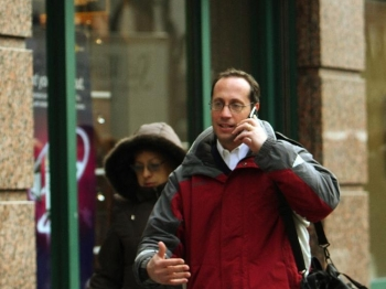 4G Phones: A man talks on a cell phone as he walks past a Sprint store on 42nd Street 15 January, 2008 in New York. (Don Emmert/AFP/Getty Images)