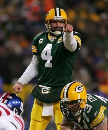 Brett Favre takes charge in last year's playoff thriller against the New York Giants.  (Jonathan Ferrey/Getty Images)