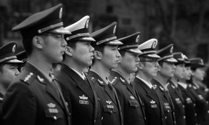 Army officers attend a ceremony in front of the Monument in Memory of the Victorious Crossing of the Yangtze River, on April 23, 2008 in Nanjing of Jiangsu Province, China. (China Photos/Getty Images)