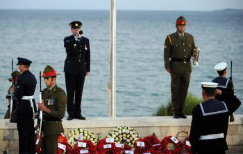 Australian soldiers stand guard as as a bugle is played during a dawn ceremony at Anzac Cove where the first battle was fought in Gallipoli. (Burak Kara/Getty Images)