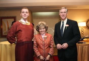 Han Couture model (L), Annette Lantos (center), and Richard Swett (right) pose for photo at the Washington, D.C. Epoch Times Nine-Year Anniversary Celebration. (Lisa Fan/ The Epoch Times)