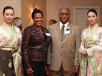 Mr. Kenneth Clark, president and CEO of the Minority Supplier Development Council of Washington, D.C. and Maryland, and his wife are joined by Han Couture models (left to right) Shirley Dai, Christie Sammet and Peter Benedetti. (Lisa Fan/ The Epoch Times)