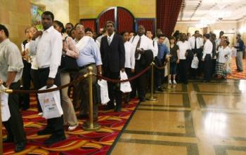 People wait in line to enter the Diversity Job Fair at the Affinia Hotel June 10, 2008 in New York City. The national unemployment rate rose to 5.5 percent in May, up from 5 percent in April. (Mario Tama/Getty Images)