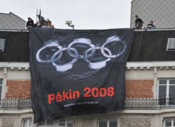 Reporters Without Borders replaced the rings in the traditional Olympics logo with handcuffs as part of a campaign to call for a boycott of the Beijing Olympic Games. (Dominique Faget/AFP/Getty Images))