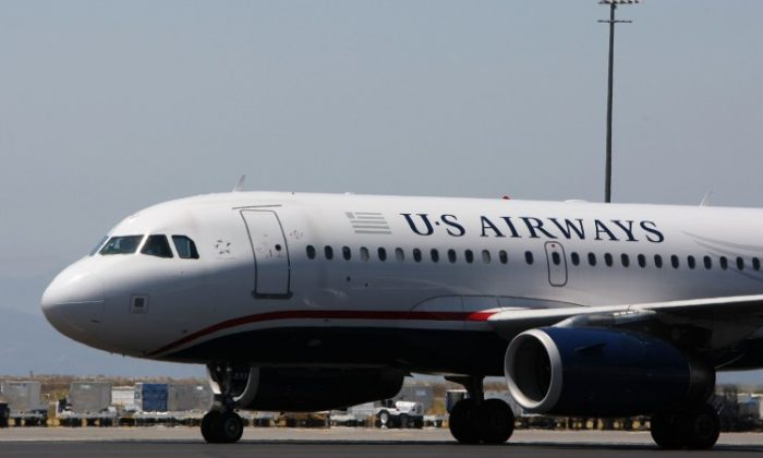 A US Airways plane taxis on the runway at the Oakland International Airport in Oakland, Calif. Jet fuel prices have reached record highs, cutting into profits and changing the way airlines operate to offset costs. (Justin Sullivan/Getty Images)