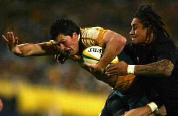 Deans� coached Australian team has won five-from-five�The Wallabies Adam Ashley-Cooper is tackled by the All Blacks� Rodney So�Oialo last Saturday night July 26. (Matt King/Getty Images)