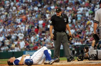In a hard –fought series, David Murphy of the Texas Rangers is down after a home plate collision with Pudge Rodriguez of the New York Yankees in Tuesday's action. (Ronald Martinez/Getty Images)