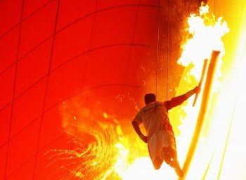 Chinese gymnast Li Ning lights the Olympic Flame during the Opening Ceremony for the 2008 Beijing Summer Olympics at the National Stadium on Aug. 8, 2008 in Beijing, China. (Julian Finney/Getty Images)