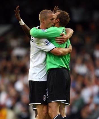 RELIEF! Fulham's Brede Hangeland (left) hugs is goalkeeper Mark Schwarzer after his team hung on to upset Arsenal. (Jamie McDonald/Getty Images)