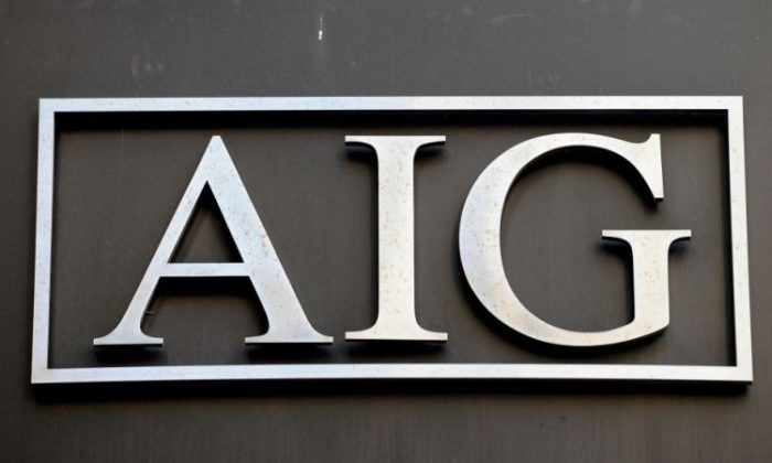 Logo of American International Group Inc. (AIG) outside its office in lower Manhattan in this file photo. AIG benefited greatly from Treasury's gift of $17.7 billion, boosting its net earnings to $19.9 billion during the fourth quarter of 2011. (Stan Honda/AFP/Getty Images)