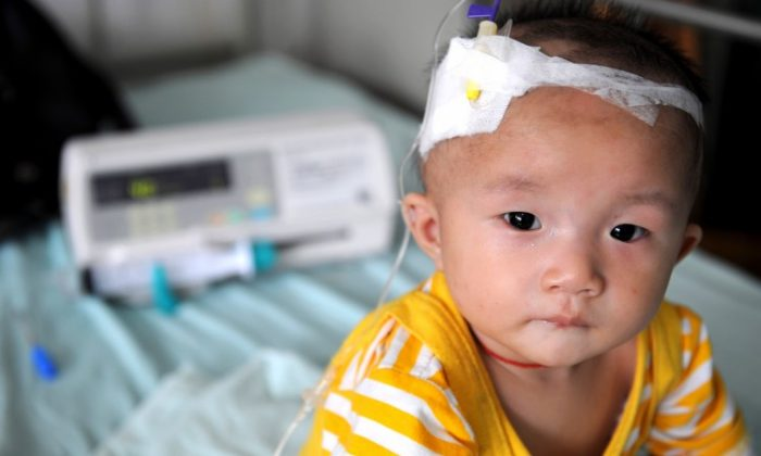 A baby who suffers from kidney stones after drinking tainted milk powder, gets IV treatment at the Chengdu Children's Hospital on Sept. 22, 2008 in Chengdu of Sichuan Province, China. (China Photos/Getty Images)