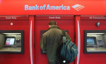 A man stands in a Bank of America ATM branch October 6, 2008 in New York City. Bank of America announced it would spend up to $8.4 billion to restructure the shaky mortgage loan portfolio of lender Countrywide. Bank of America also reported a third-quarte (Mario Tama/Getty Images)