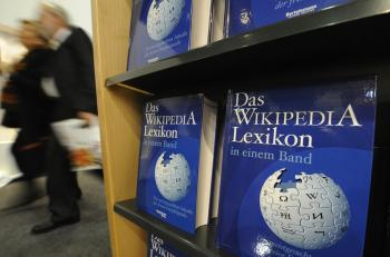 Copies of the 'One-Volume Wikipedia Encyclopaedia' are on display at the Frankfurt Book Fair on October 16, 2008. Wikipedia, the pervasive, nonprofit, user-driven online encyclopedia project celebrated its 10th anniversary on Saturday.  (John Macdougall/Getty Images)