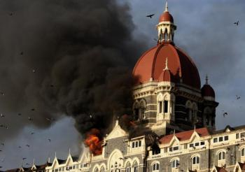 Flames and smoke gush out of the historic historic Taj Mahal Hotel in Mumbai on November 27, 2008, one of the sites of attacks by alleged militant gunmen. (Indranil Mukherjee/AFP/Getty Images)