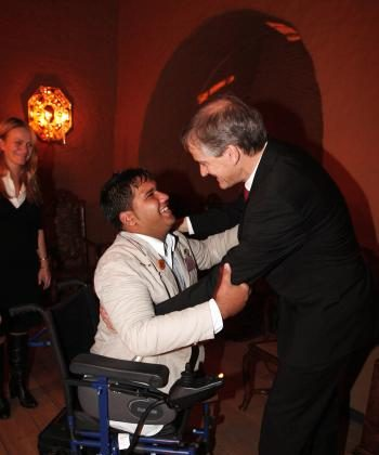 Norwegian Minister for Foreign Affairs Jonas Gahr Stoere (R) welcomes Afghan cluster bomb survivor Soraj Ghulam Habib to a dinner after signing the Convention on Cluster Munitions in Oslo. (Junge Heiko/AFP/Getty Images)