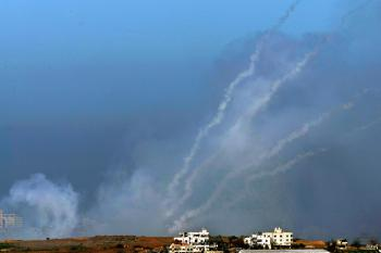 A barrage of four Palestinian Qassam rockets leave smoke trails in the sky as they are fired by Hamas militants on January 6, 2009 inside the Gaza Strip towards the Israeli town of Sderot, as seen from Israel's border with the Palestinian territory (David Silverman/Getty Images)