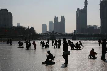 People on the frozen Haihe River on January 26, 2009 in Tianjin, China.  (China Photos/Getty Images)