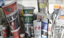 Chinese Garbage Collector: Party Newspapers Treated Like Junk Mail