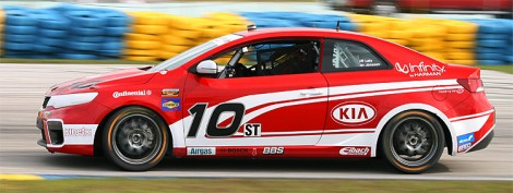 Teammate Andy Lally was right behind in the #10 Kinetic/Kia car. (Chris Jasurek/The Epoch Times)