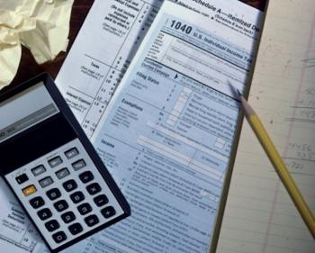 Those who itemize deductions must not file their tax returns until mid-February, according to the IRS. Congress changed tax laws at the end of 2009. (Photos.com)