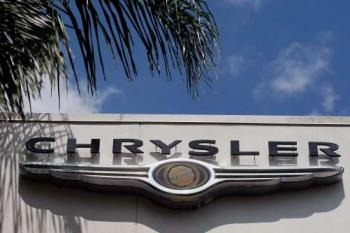CHANGE: A Chrysler sign hangs at Maroone Chrysler Jeep Dodge dealership in Coconut Creek, Florida. Italy's Fiat automobile took over the company on June 10. (Joe Raedle/Getty Images)