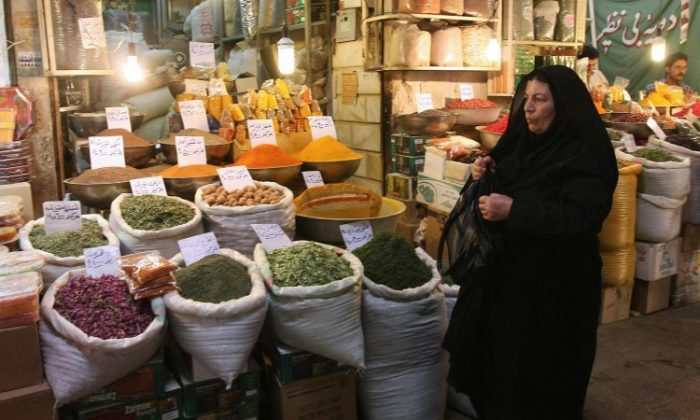 An Iranian woman shops at a bazaar in Isfahan, Iran, on July 7, 2009. (Ehsan Khosravi/AFP/Getty Images)