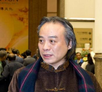 Mr. Yihan, Chinese ink painting artist and art critic, attends the Divine Performing Arts Show in Taipei on March 1, 2009. (Tang Bin / The Epoch Times)